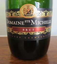 Domaine Ste Michelle Brut - a light and delicate bubbly that is not too dry with fruity aromas of crisp apples and citrus. Enjoy with a wide variety of foods from appetizers to main dishes. Priced around $10.