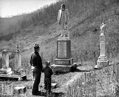 The Hatfield-McCoy Feud - Hatfield Cemetery with Devil Anse's son Joe and grandson in the photo