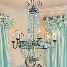 aqua chandelier and window treatment