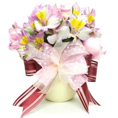 Quick and Easy Mother's Day Gift - Flower Bouquet with Bow Design an exquisite bow using the Bowdabra. Attach your pretty bow to a flower bouquet for mom this Mother's Day.