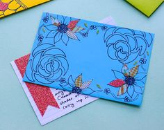 Index cards with washi tape for cute, quick stationary. Decorate coordinating brightly-colored envelope with doodles and washi tape.