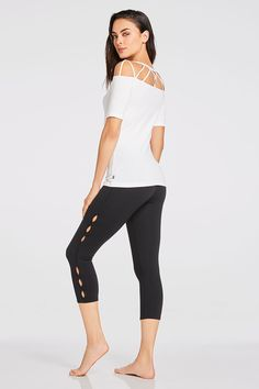 Commit to cutouts this spring in our strappy tee and keyhole-designed  capris with maximum compression fabric and UPF protection. 3e6897e21
