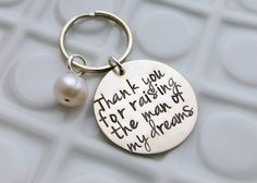 Mothers Day Gift - Thank you for raising the man of my dreams - Hand Stamped Keychain. $28.50, via Etsy.