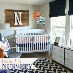 baby boy nursery ideas: Wood Board with initial, pop of color with orange and blue