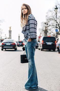 http://cliqueimg.com/cache/posts/187082/how-to-wear-flared-jeans-like-miroslava-duma-1696479-1458023027.640x0c.jpg