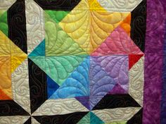 Love the colors and quilting!