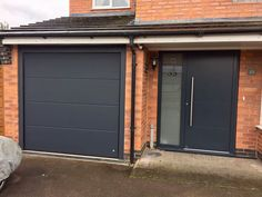 Leicester based CMS Doors supply and fit Sectional Garage Doors, Roller garage doors and Alluguard Garage Doors acorss Leicestershire, Nottingham, Derbyshire Front Door Porch, House Front Door, House With Porch, House Entrance, Entrance Doors, Grey Garage Doors, Garage Door Styles, Grey Front Doors, Modern Front Door