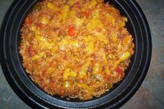 A spicy rice dish that is started on top of the stove and cooked in the oven. - Oven Baked Spanish Rice