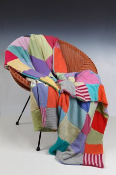 Cashmere Throw by Cathy Ridge. This double sided cashmere lap throw is warm, luxurious and big enough for two! Rectangular blocks, six inches by twelve inches, make up a colorful patchwork. Both sides are equally lovely.
