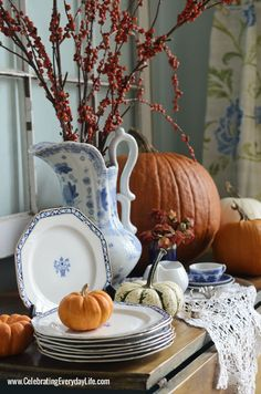 Buffet with bittersweet, pumpkins, blue & white china, A Blue Willow Thanksgiving Tablescape, Blue and White Thanksgiving Table, Blue and Wh...