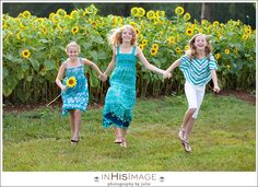 girls skipping in sunflower field