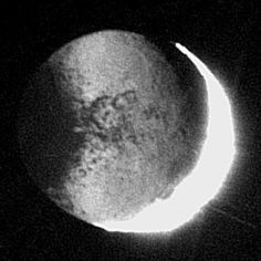Saturn's moon Iapetus lit by Saturnshine. This is an enhanced picture; the planetshine is too dim by contrast to be visible to the unaided eye. Facts About Saturn, Saturns Moons, Spacecraft, Nasa, Sunlight, Distance, Evans, Contrast, Articles