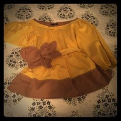 Chic flirty vintage look top Flirty mustard colored top with brown accents and bow belt.  100% cotton.  Belt closes with three snaps.  Fourth pic is stock photo.  Worn once! Ryu Tops Blouses
