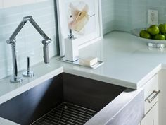 A contemporary play on the classic farmhouse form, a stainless steel apron-front sink boasts clean, simple lines.