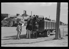 Russell Lee - Mexican day laborers being loaded into truck for transportation to field, Weslaco, Texas (1939)