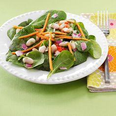 White Bean and Spinach Salads Recipe -This is one of my favorite summertime salads. Fresh parsley, tarragon and chives give the homemade dressing special flavor. Packaged pre-cut matchstick carrots make it a snap to fix! —Elisabeth Larsen, Pleasant Grove, Utah
