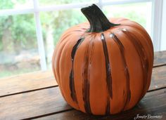 Pin for Later: A Clever Hack For Making Plastic Pumpkins Look Real  After watering down the paint, brush it onto the pumpkin.