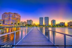 West Palm Beach cityscape photos from downtown at the waterway in Palm Beach County during sunset. HDR image created using Photomatix Pro and Topaz software.