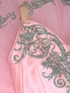 detail of tutu decoration in silver on pale pink