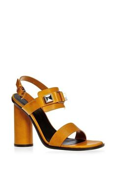New York duo **Proenza Schouler** continues to stake their claim as a fashion industry darling with their collections of lust-worthy womenswear and accessories. Modeled after their uber popular Ps1 bag, these sandals deliver fashion-forward style with a sturdy, walkable heel.