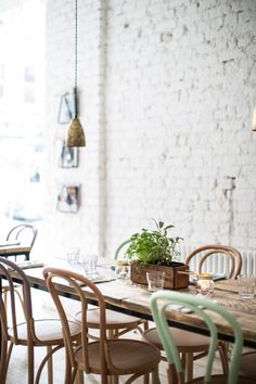 PAINTED BRICK, GREEN CHAIR, CAFE INTERIOR BY ALEXANDER WATERWORTH INTERIORS