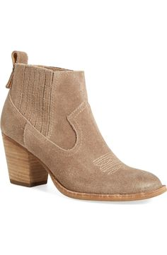 A wear-anywhere suede bootie fashioned with an almond-toe cut and chunky stacked heel that's perfect for fall.