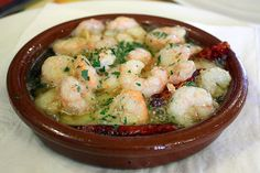 My mother-in-law's gambas al ajillo recipe is one of Spain's best. Piping hot garlic shrimp, smothered in olive oil with a slightly spicy kick!
