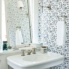 Blue Bathroom | A pedestal sink leaves much to be desired when it comes to storage. Extending the windowsill into a built-in ledge stylishly solves the problem. | SouthernLiving.com