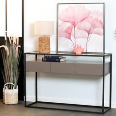 Console d'entrée 120 x 40 cm en métal avec plateau supérieur en verre et 3 tiroirs en bois peint. Ce meuble au style très contemporain s'intègre parfaitement dans une entrée et vous offrira de l'espace de rangement pour tous vos besoins. Look design moderne, le bois gris associé à des matières comme le verre et le métal sont des tendances déco et des valeurs sûres. Cette console peut également être utilisée dans un salon pour y installer une lampe par exemple. Design Moderne, Console Table, Cabinet, Storage, Comme, Furniture, Home Decor, Unique, Modern Entrance