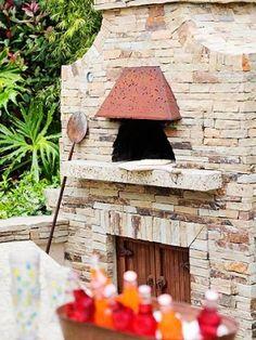 Pizza Oven: love the copper hood and wooden doors below