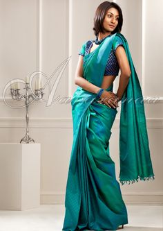 A Kanchipuram saree also called Kanjeevaram saree is made in Kanchipuram in Tamil Nadu. These are naturally woven and are considered to be of very high quality.The contrasting and vibrant color of the designer. Indian Silk Sarees, Pure Silk Sarees, Indian Lehenga, Indian Attire, Indian Ethnic Wear, Indian Dresses, Indian Outfits, Phulkari Saree, Banarasi Sarees