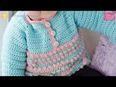 Learn how to crochet this really super cute baby sweater. It has amazing stitch work that is bound to impress anyone. The pattern lends itself to be boys or ...