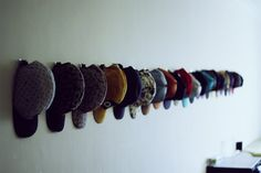 Have a naked wall to use, or an enclosed display case, or an area that nothing else works in? HATS can be so easily displayed with removable wall hooks.