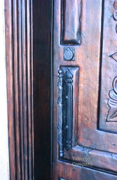 Mediterranean style front door with hand forged iron door pull from Taberandcompany.com