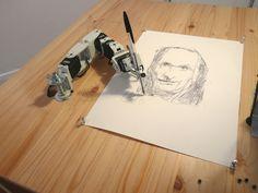 robot arm drawing portraits