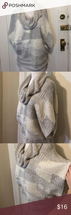 Calvin Klein jeans gray ivory Cowl neck sweater This is a cozy fall sweater by Calvin Klein jeans, gray and ivory pattern, lightweight, Cowlneck, short-sleeved. Good condition minor wear, minor pilling. Be sure to check out other items in closet and bundle to receive discounts. Calvin Klein Jeans Sweaters Cowl & Turtlenecks