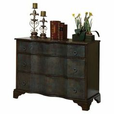 "3-drawer chest with a weathered teal finish and ring drawer pulls.  Product: ChestConstruction Material: Engineered wood, pine and pine veneerColor: Weathered teal and brownFeatures: Three drawersDimensions: 32"" H x 42"" W x 18"" D"