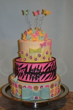 A tiered cake for 3 girls