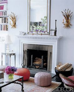 A pair of gold-leafed sheaf sconces in this celebrity living room.