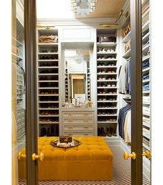 Clean and organized. Loved the idea of an oversized ottoman in closet