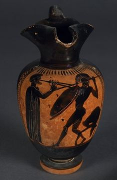 Pottery: black-figured oinochoe showing a warrior dancing the Pyrrhic, from the Panathenaia.