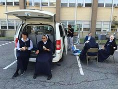 Nuns tailgate while waiting for the Pope.
