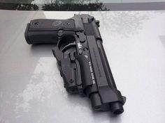 Beretta 92FS The 92FS is the go-to pistol of Burn Notice's Sam Axe.