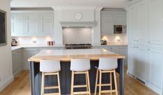 This beautiful kitchen by Stanford Design uses the half pencil and scalloped beading in Partridge Grey and Charcoal