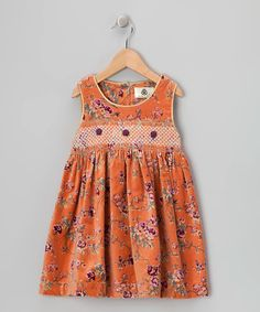 Take a look at this Lil Cactus Wild Orange Rose Smocked Corduroy Dress - Girls on zulily today!