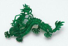 Carved Jade Dragon Brooch   Platinum, signed Cartier, # 1381757.