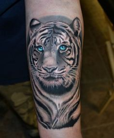 The eyes on this white tiger are mesmerizing. They are so lifelike that it's hard to believe that this is a tattoo. #InkedMagazine #tiger #tattoo #tattoos #inked #art