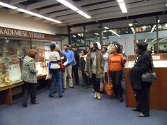 Marié Coetzee and the some of the delegates in the Van Schaick Room of the Unisa Library . Photo: Unisa Library