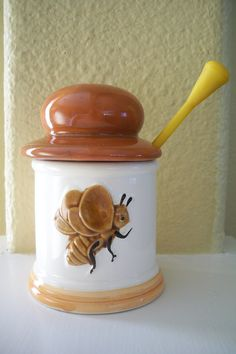 BEE~Vintage ceramic honey jar with bee on front. via Etsy. Hives And Honey, My Honey, Tostadas, Vintage Cake Plates, Honey Jars, I Love Bees, Kitchen Jars, Sweet Magnolia, Bee Theme