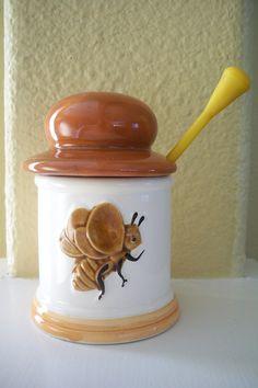 Vintage ceramic honey jar with bee on front. via Etsy.